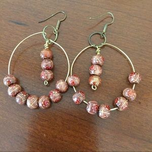 Gold and bead dangling earrings